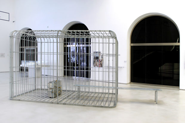 H.H.Lim, The cage the bench and the luggage, 2011, galvanized steel and aluminium suitcase with padlocks and chain, 484 x 216 x 228 cm, Collection of the artist, exhibition view at MAXXI, photo: Cecilia Fiorenza